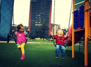 Swinging on the big kid swings!