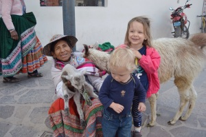 Posing with a local highland mamita and vicuña