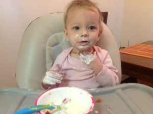 Olivia eating plain yogurt at 10 months