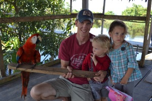 Holding the Macaw...Olivia wasn't so sure about this.